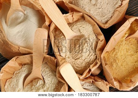 Bags with different types of flour, closeup