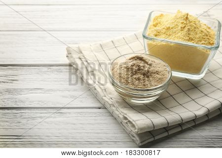 Composition with flour on wooden table
