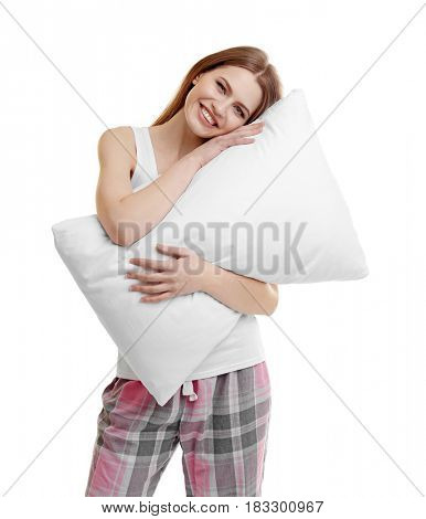 Young happy woman in pajamas holding orthopedic pillow on light background. Healthy posture concept