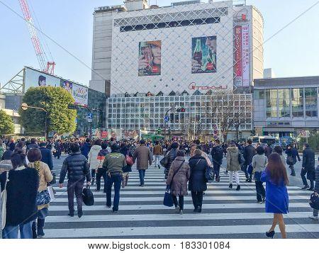 Tokyo Japan - January 28 2016 :Pedestrians cross at Shibuya Crossing in Tokyo Japan.