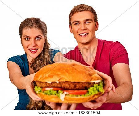 Couple eating fast food. Man and woman treat big hamburger with ham . Friends give burder junk on white background isolated.
