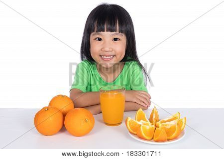 Happy Asian Chinese Little Girl Drinking Orange Juice