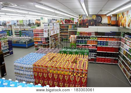 ROME, ITALY. March 26, 2014: Grocery shop shelves, beverage department, with products inside a new market (M.A. Supermarket) opening in Rome, Italy.