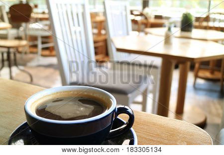 Sipping a cup of coffee at a relaxing space