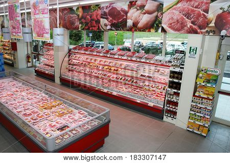 ROME, ITALY. March 26, 2014: Meat department shelves with typical Italian raw meat inside a new market (M.A. Supermarket) opening in Rome, Italy.