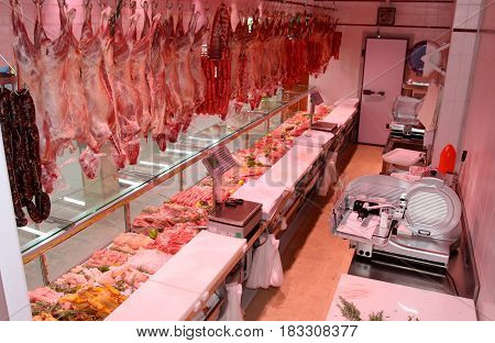 ROME, ITALY. March 26, 2014: Shelves with typical Italian raw meat inside a new market (M.A. Supermarket) opening in Rome, Italy.