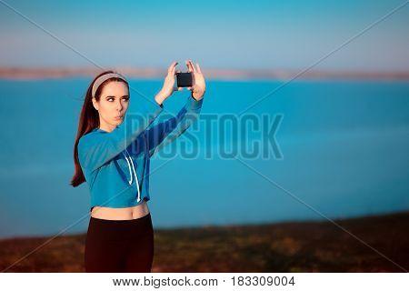 Cute Girl In Sportswear Outfit Taking a Selfie