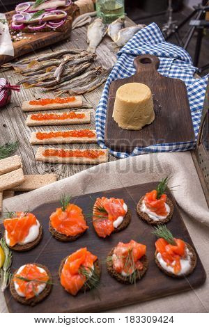 Still life - traditional Norwegian cuisine - Brunost and fish