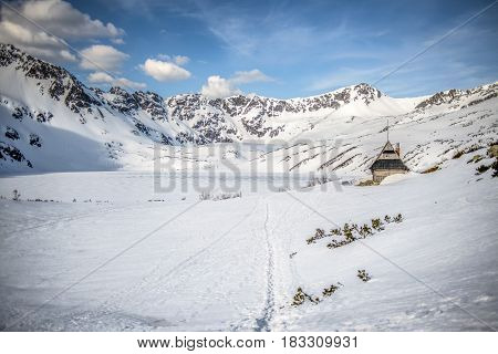 Winter landscape of Tatry mountains in winter Poland. Piec stawow.