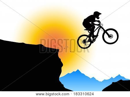 Silhouette of a biker jumping from mountain ledge with mountains in the background