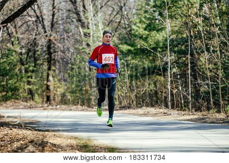 Chelyabinsk Russia - April 22 2017: male runner middle-aged running in city park in Spring half marathon