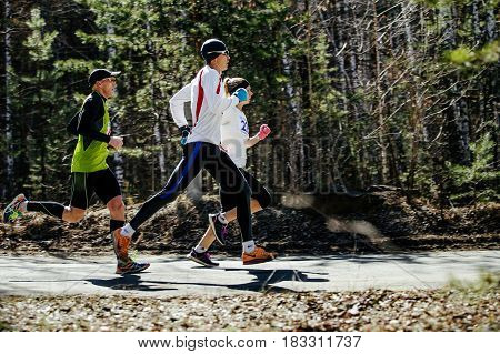 Chelyabinsk Russia - April 22 2017: group leaders of marathon competition run in Park during Spring half marathon