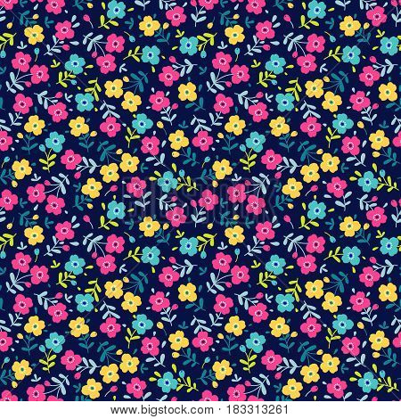 Cute seamless pattern in small flower. Small colorful flowers. Dark blue background. Ditsy floral background. The elegant the template for fashion prints.