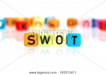 colorful word cube of SWOT on white background