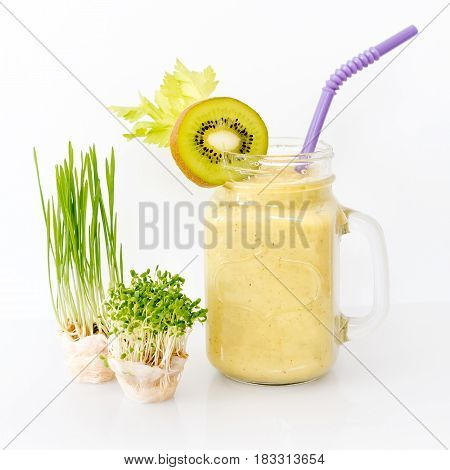 Growing micro greens with smoothie cocktail on white background. Healthy eating concept of fresh garden produce organically grown as a symbol of health