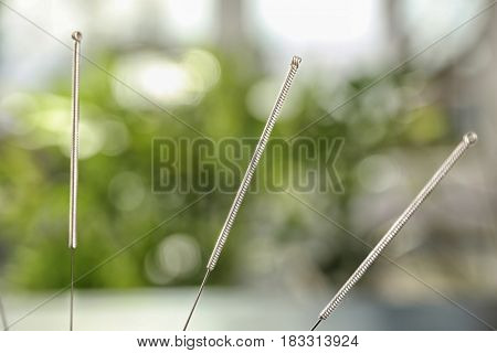 Needles for acupuncture on blurred background, closeup