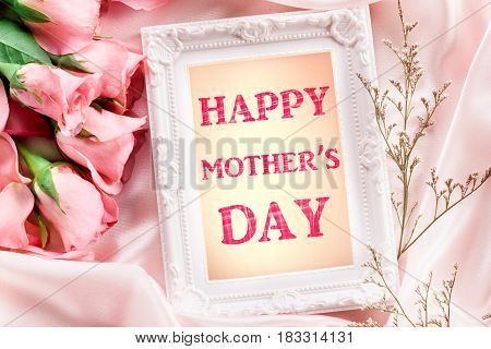 Happy Mother's Day paper card with sweet pink roses petal on silk Love on Mother's day card concept