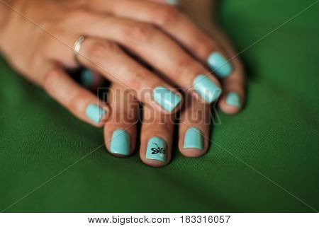 Nails On The Fingers Are Colored With Varnish