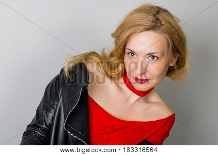 Beautiful woman with a serious look at the wall. Woman is forty years old.