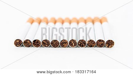 Stack of cigarette on the white background with partial focus