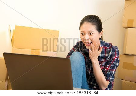 Woman Using A Laptop Excited