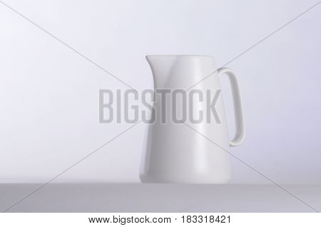 White coffee mug and white background low key