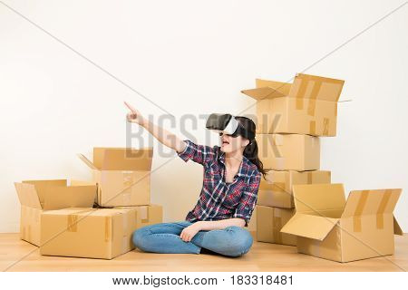 Woman Unpacking With Vr Headset