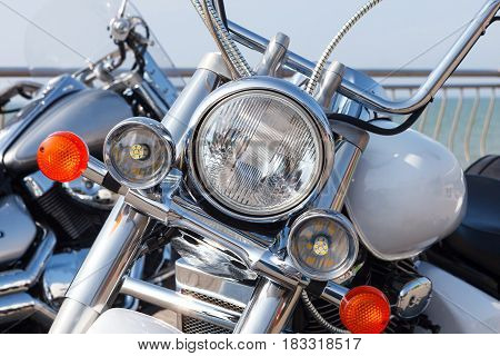 Motorcycle front details. Big chrome motorcycle headlight