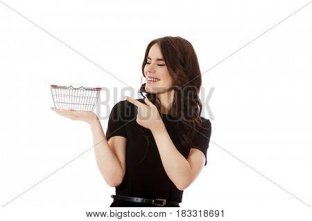 Woman holding mini shopping cart