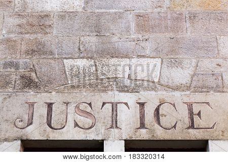 Justice sign on a wall in France