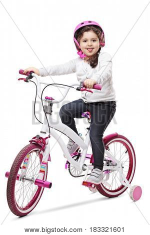 Cute little girl on a bike sticking her tongue out and looking at the camera isolated on white background
