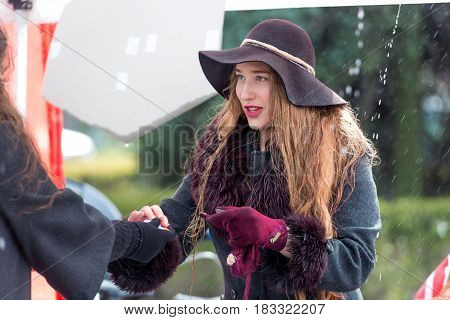 RIGA LATVIA - APRIL 22 2017: Tweed ride 2017.  It's raining. Unknown woman registers bicycle journey.