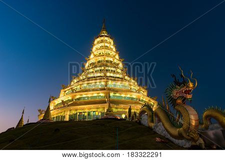 Golden Pagoda nine tier with dragon texture at Chinese temple - wat hyua pla kang temple, Chiang Rai, northern of Thailand, one of the most beautiful popular temples in Thailand