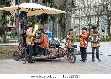 RIGA LATVIA - APRIL 22 2017: Tweed ride 2017. Bicycle Orchestra event during the opening play music and sing songs.