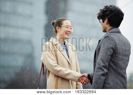 Happy businesswoman introducing herself to partner