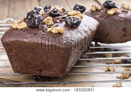 Homemade chocolate cake with prune and walnuts