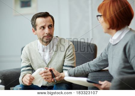 Anxious middle-aged man visiting psychiatrist