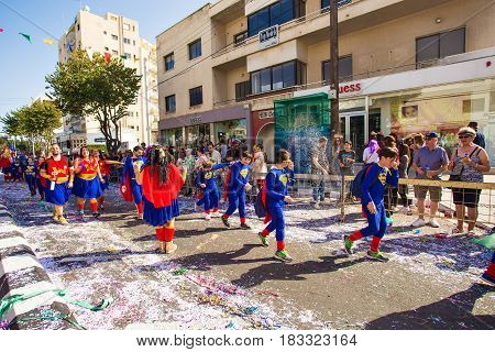 LIMASSOL, CYPRUS - FEBRUARY 26: Grand Carnival Parade - an unidentified people of all ages , gender and nationality in colorful costumes during the street carnival