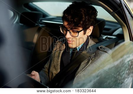 Business professional networking on backseat of cab
