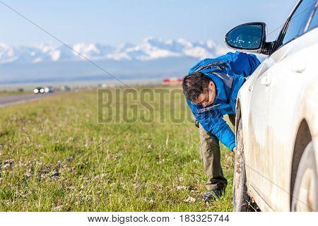 washing car in grassland