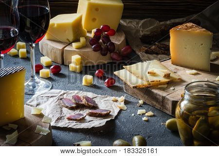 Cheese Platter Of Chopped Hard Cheeses (swedish, Spanish Manchego) And Sliced Italian Pecorino Tosca