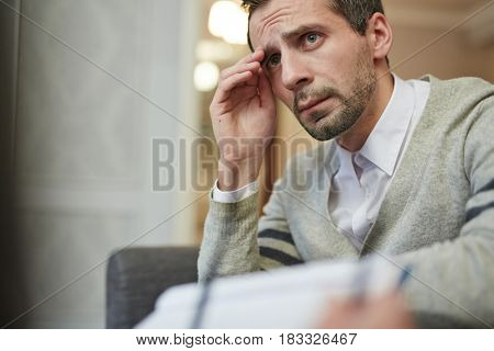 Unhappy man addicted to something destructive looking for psychological support