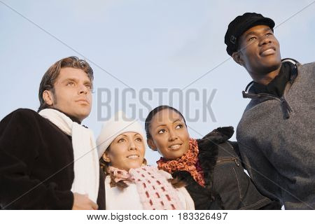 Low angle view of multi-ethnic couples