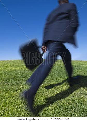 African businessman running uphill