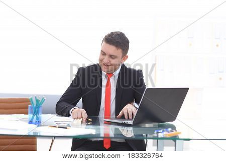 Young employee looking at computer monitor during working day in office