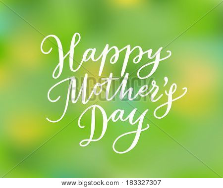 Happy mothers day card with hand drawn text. Lettering, calligraphy against blurred background