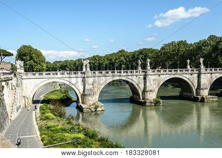a view of tevere bridge in Rome Italy