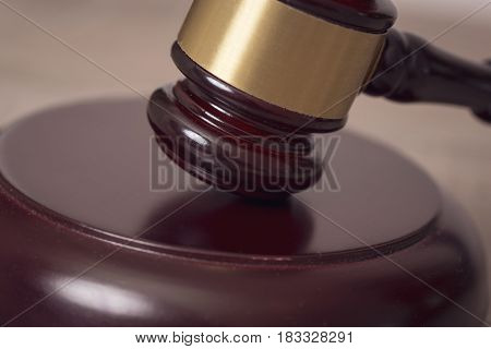 Close up of a judge gavel in a courtroom. Selective focus