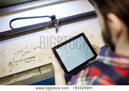 Modern engineer using sketch in touchpad during work