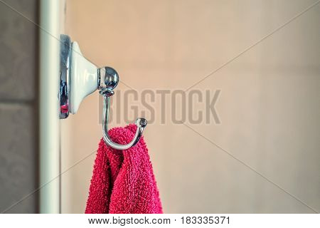 Towel is hanging on the wall in bathroom